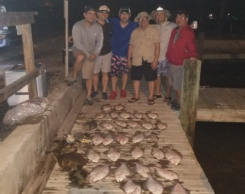 6 GUYS WITH FLOUNDER