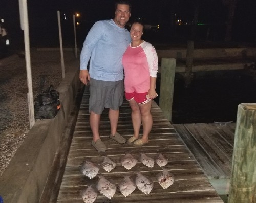 COUPLE WITH FLOUNDER