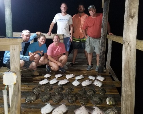 LARGE YOUNG GROUP WITH FLOUNDER